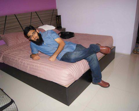 Ramay laying on the budget bangkok hotel bed