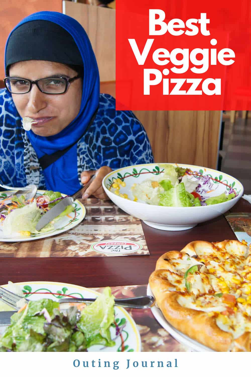 Blue Hijab Girl Trying the Veggie Pizza
