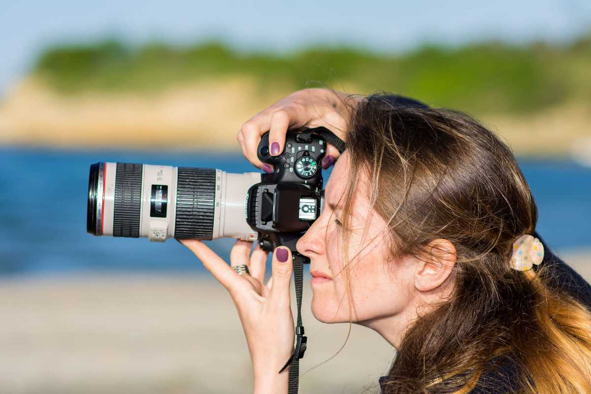 Woman Taking Picture with Canon Lens on Her Traveling Trip