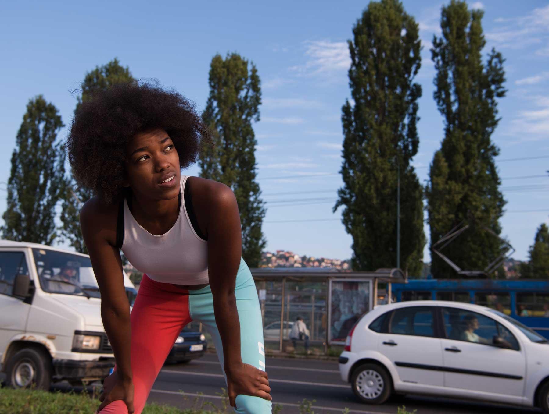Afro Girl Bending on Knees