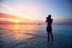 Photographer taking landscape photo