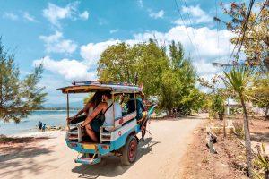Couples in Indonesia riding the horse cark tuk-tuk!