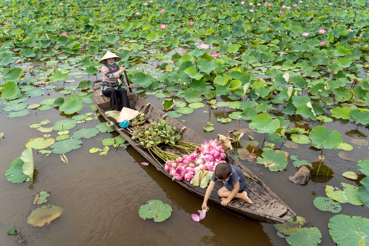 Vietnamese Lady and a Boy in a Boat